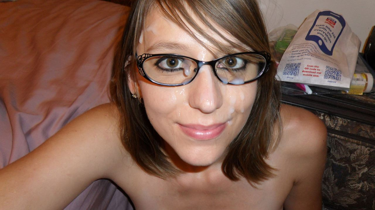 Nerdy amateur wearing glasses playing with her trimmed pussy 7